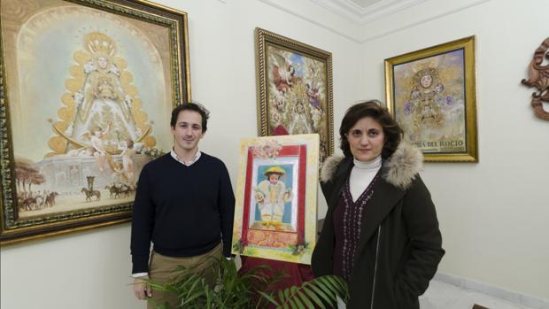 José Miguel Saavedra, delegado de Formación de la Matriz y Juana Acosta la artista almonteña artífice de la felicitación navideña