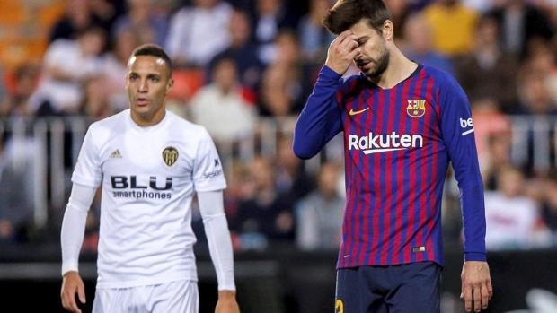 Gerard Piqué y Rodrigo Moreno en el partido liguero