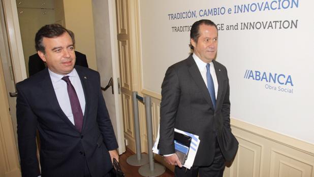 El consejero delegado de Abanca, Francisco Botas, y el propietario del banco, Juan Carlos Escotet