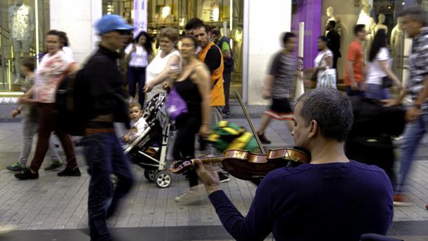 Músicos callejeros en la calle Preciados de Madrid